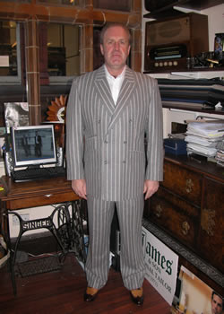 Mr Mark Ginders in his double breasted bespoke suit in scabal fabric