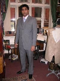 Bespoke three piece suit with waist coat